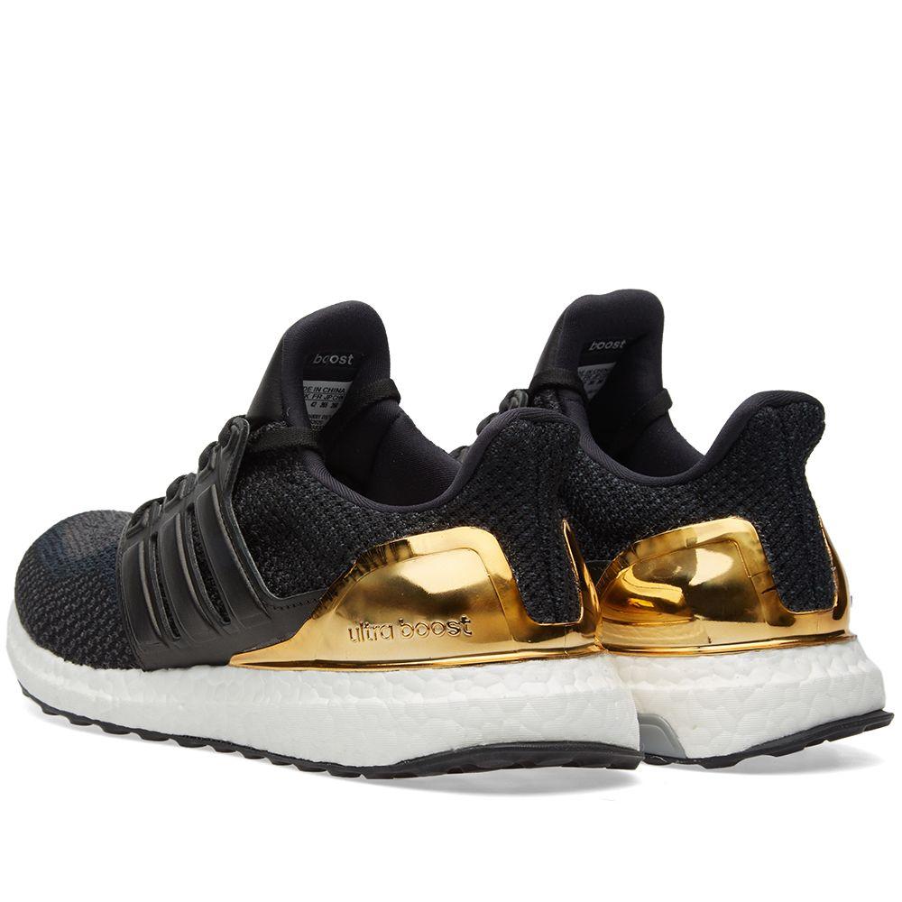 a12088494e6 Adidas Ultra Boost Ltd. Black   Gold