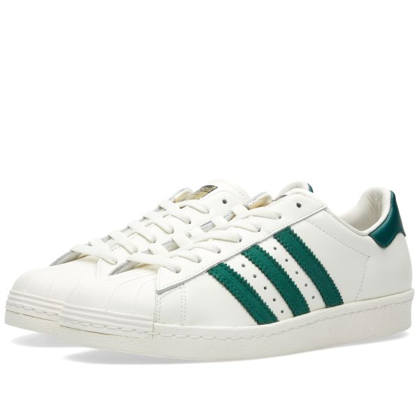 white and green adidas superstar