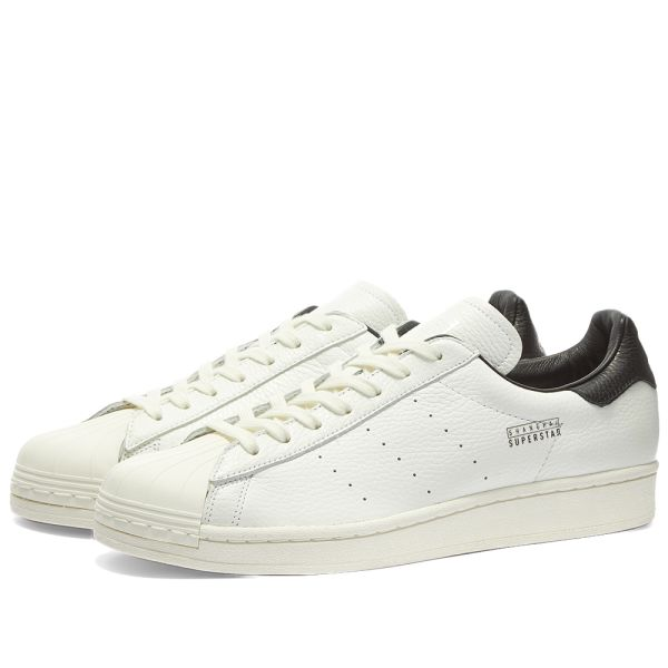 white and black adidas tennis shoes